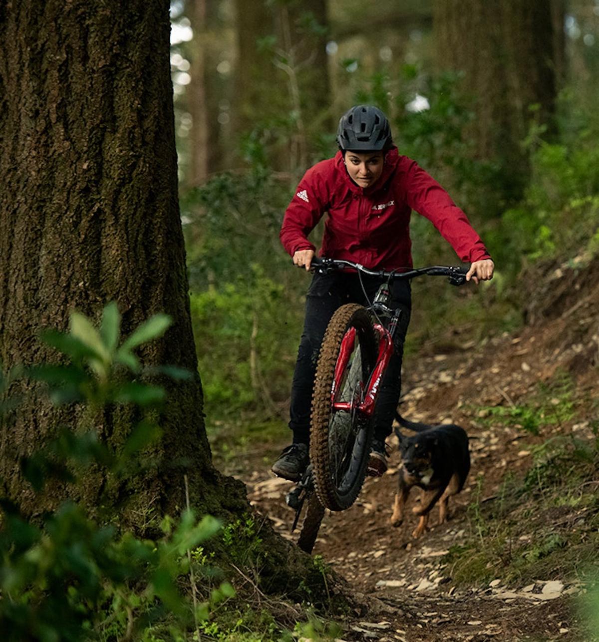 Vero riding the Santa Cruz Bronson with her dog