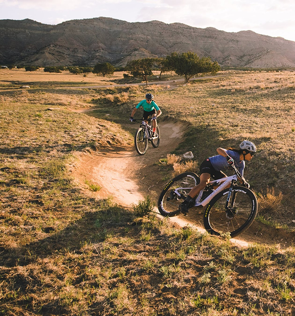 Rose Grand and Evelyn Dong riding Juliana Wilder's on a smooth flow trail
