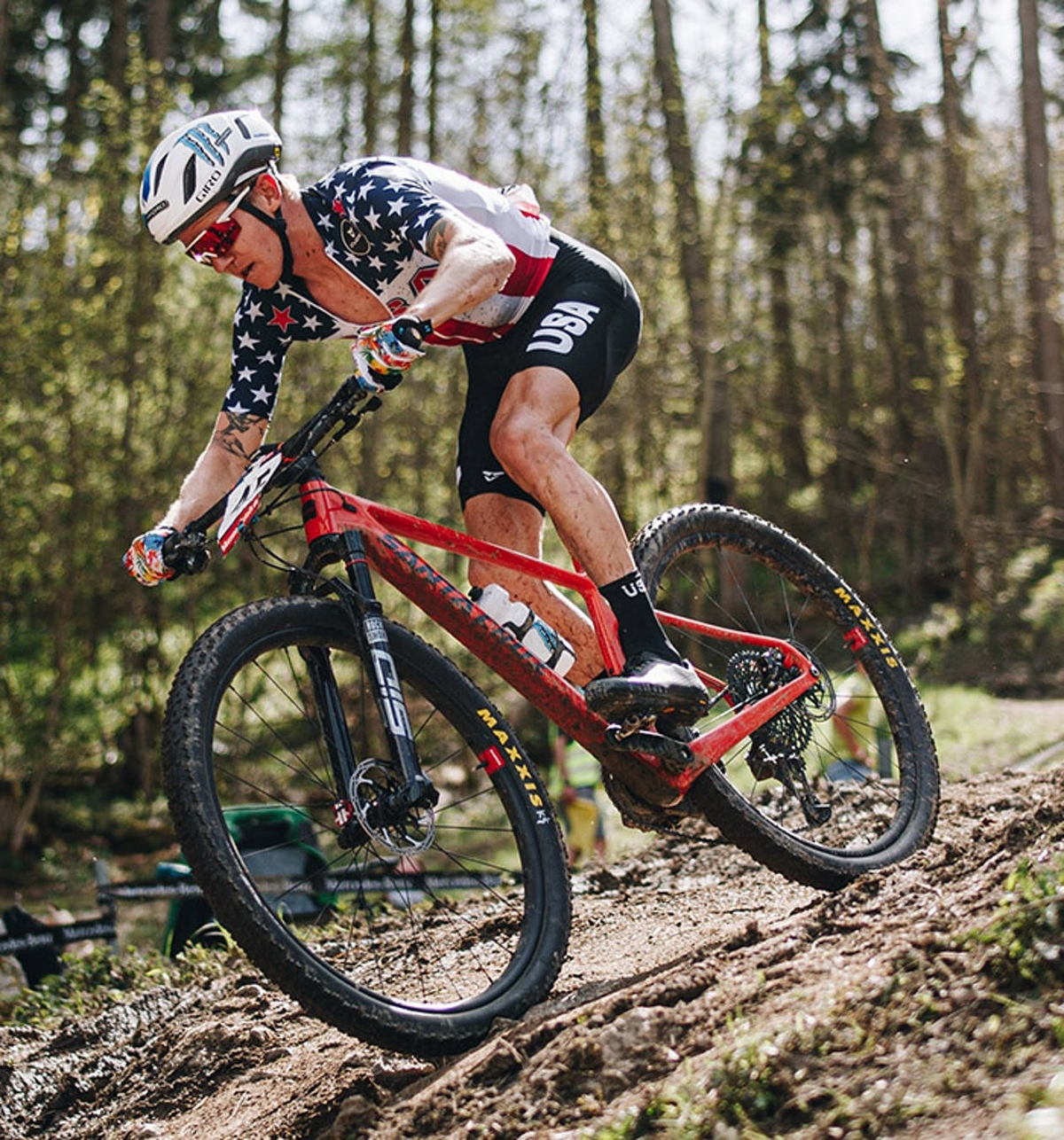 Keegan Swenson riding the Santa Cruz Highball on a muddy race course