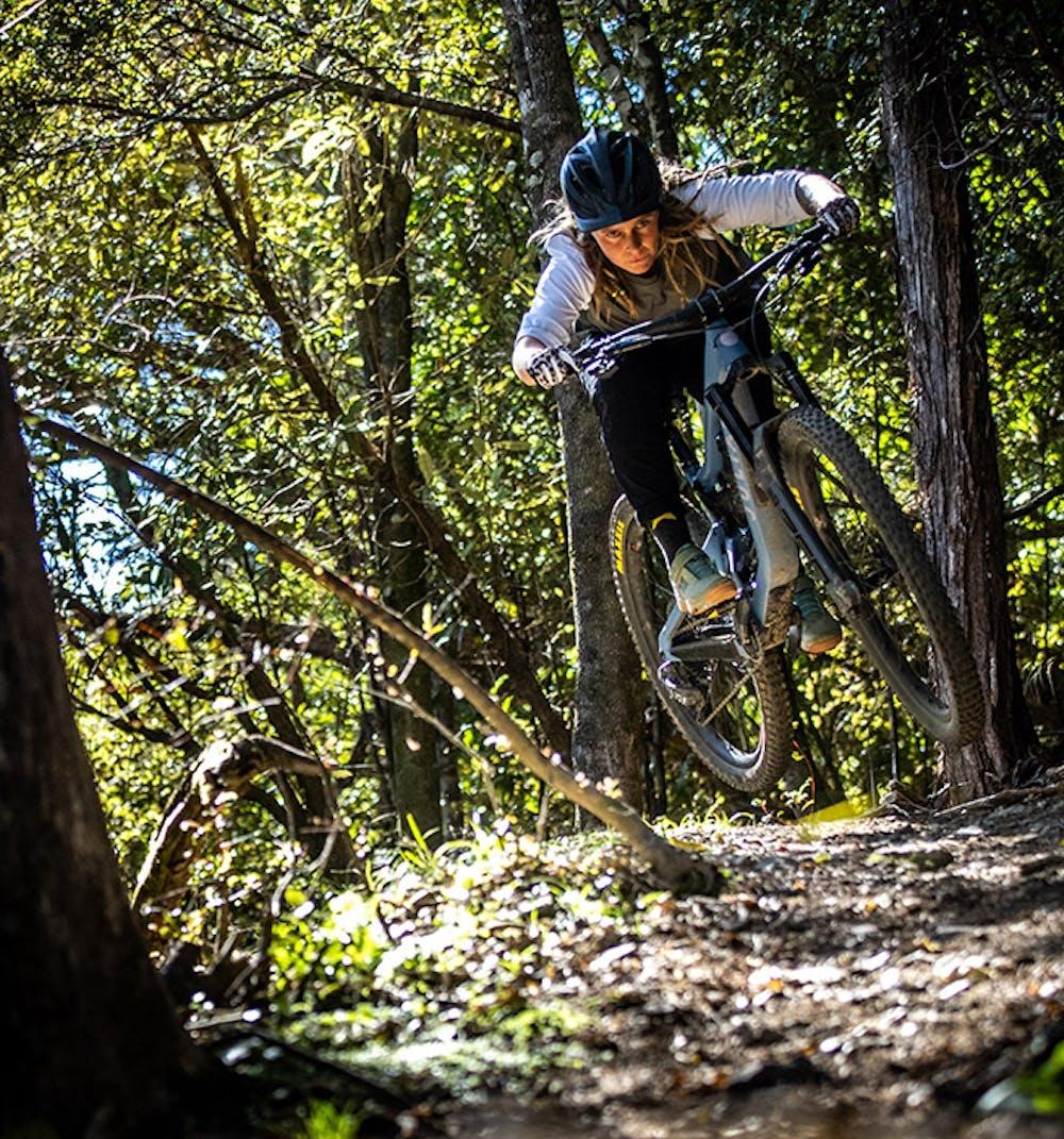 Anka Martin jumping onto a trail on her Juliana Roubion