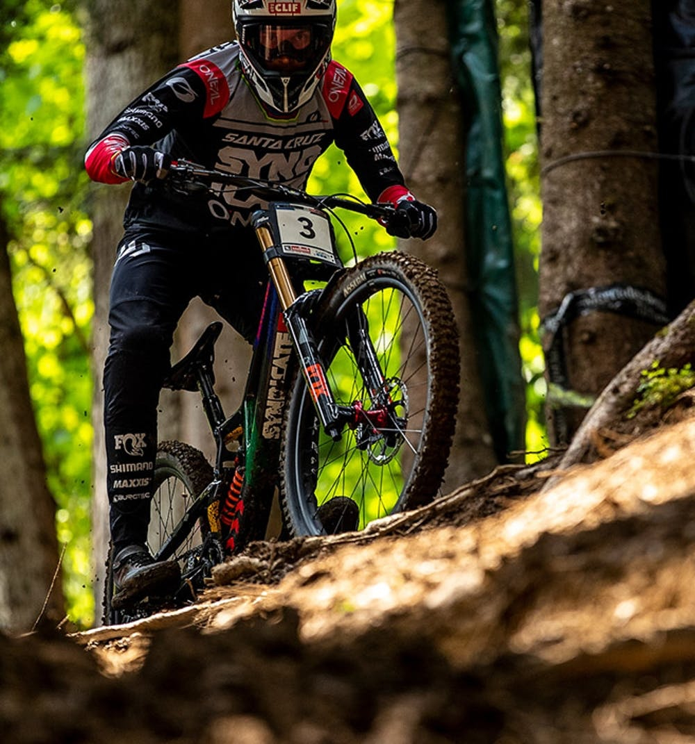 Greg Minnaar riding his V10 over some roots