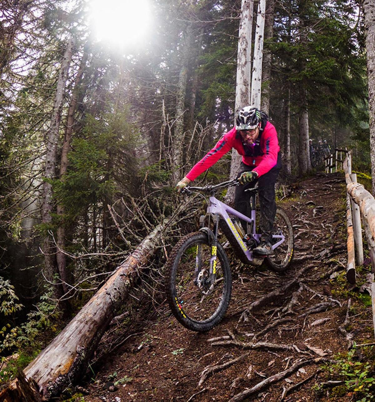 Max S. riding the Santa Cruz Bullit down a root-filled trail