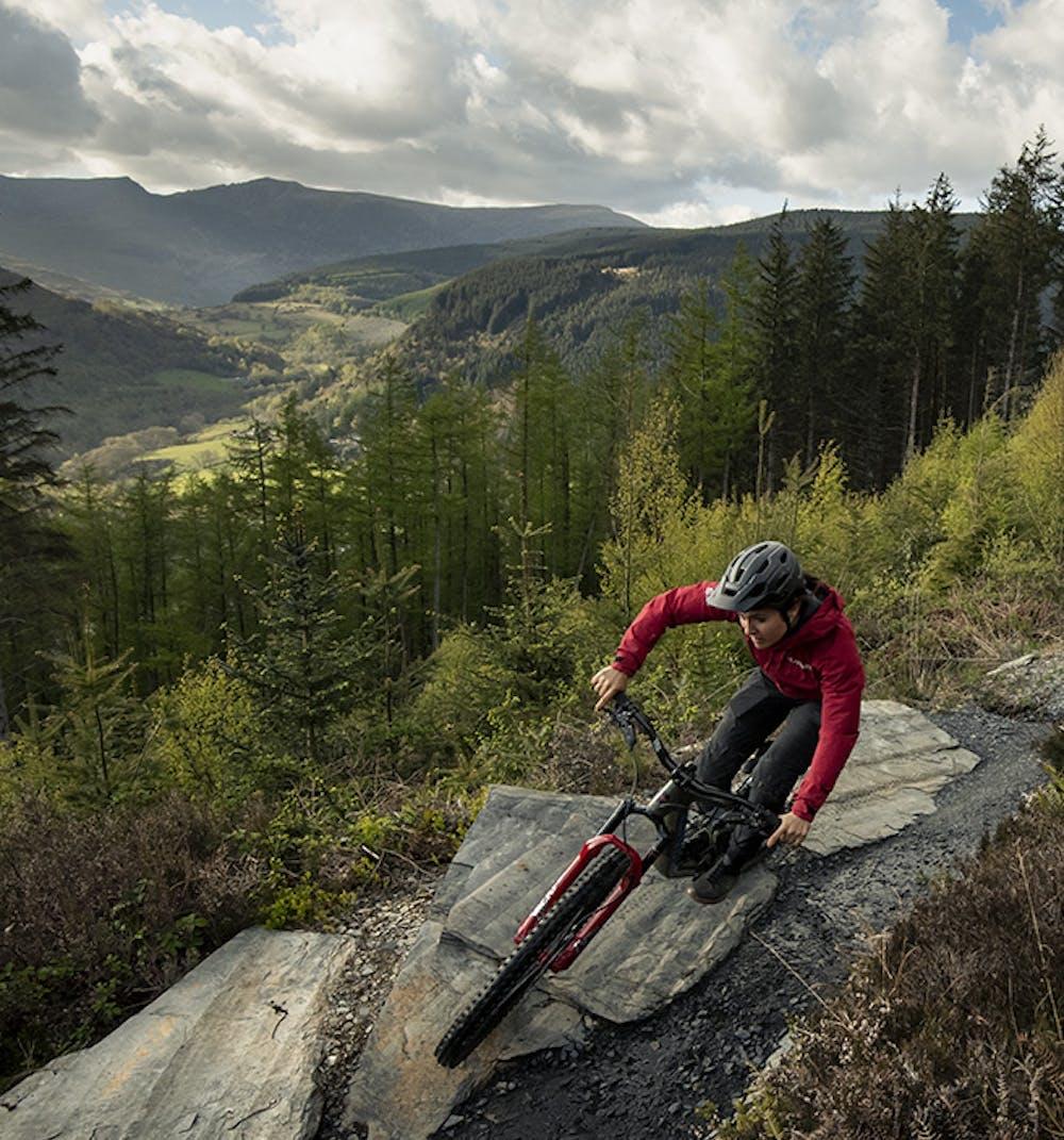 Vero S. Riding the 2022 Bronson off of a rock ledge