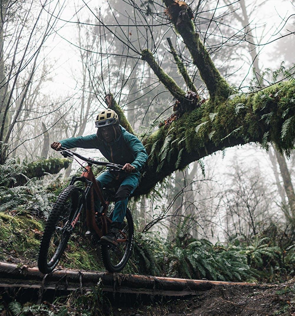 Brooklyn Bell riding off a log drop on the Juliana Furtado