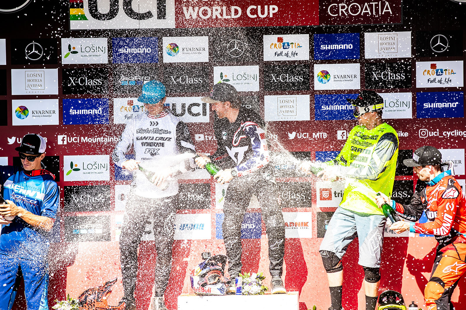 Santa Cruz Bicycles - Luca Shaw Getting Sprayed with Champagne on the Podium at the Losinj World Cup DH