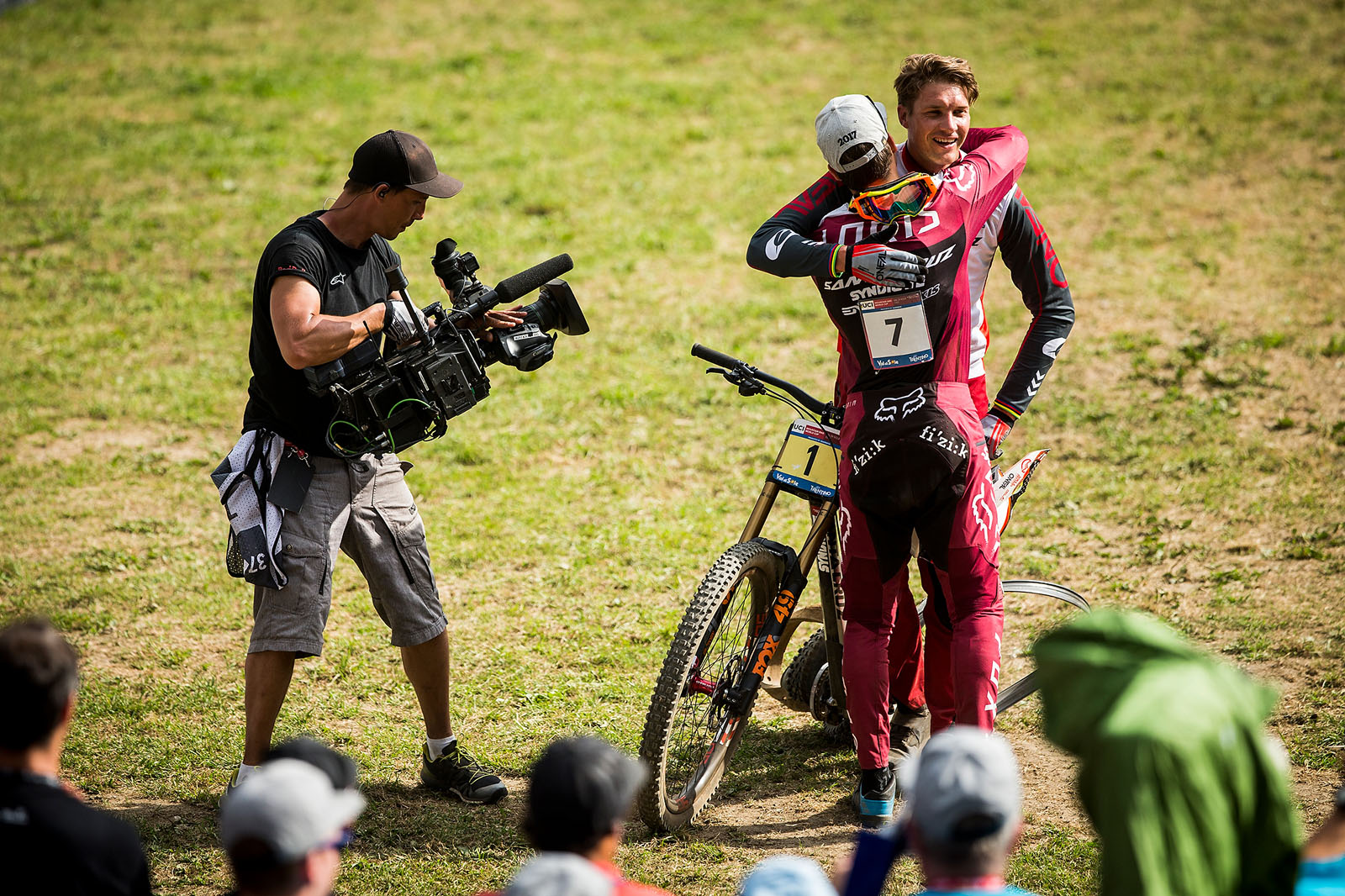 Loris Vergier hugs teammate Greg Minnaar at the finish of the Val di Sole World Cup